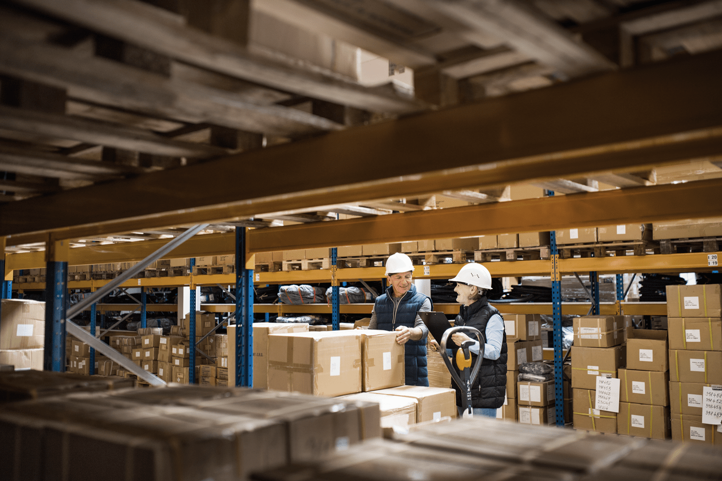 Workers checking boxes at warehouse