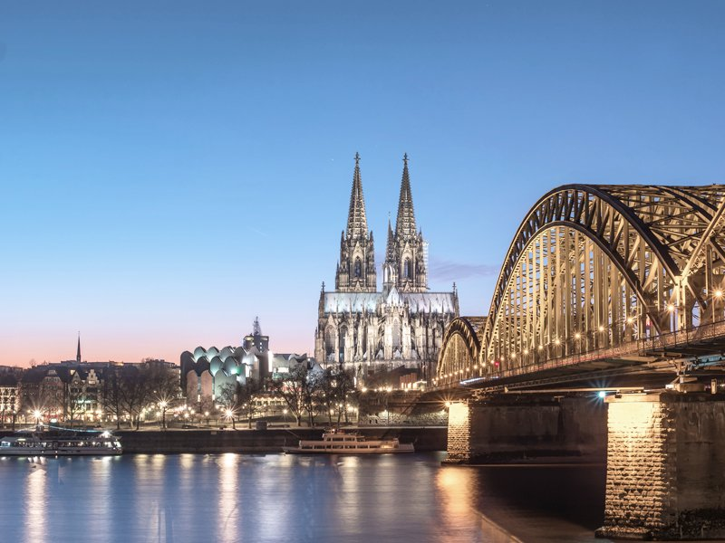 Cologne Cathedral and Hohenzollern Bridge at nighttime