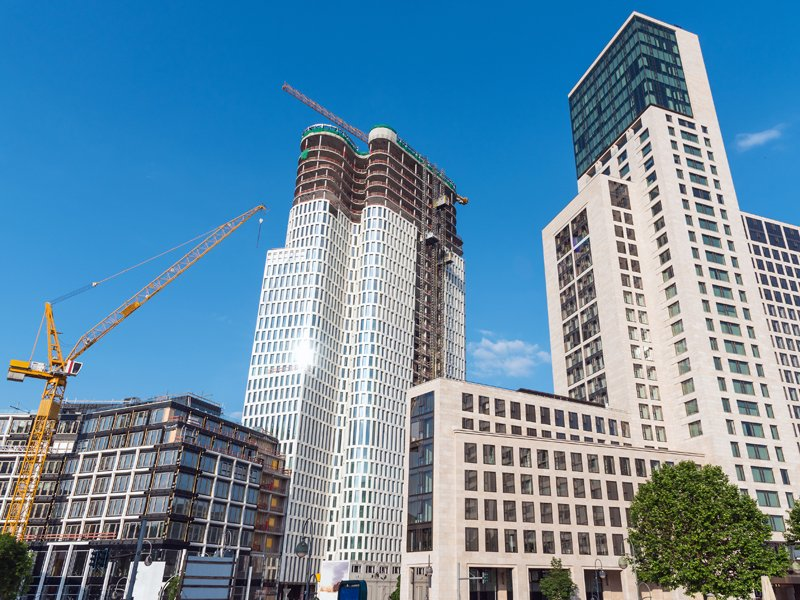 Two skyscrapers, one of them still under construction, seen in Berlin, Germany; Shutterstock ID 467640152; Departmental Cost Code: 164400; Project Code: P88430